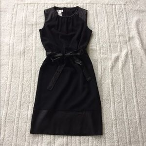 Black crepe dress with satin accents
